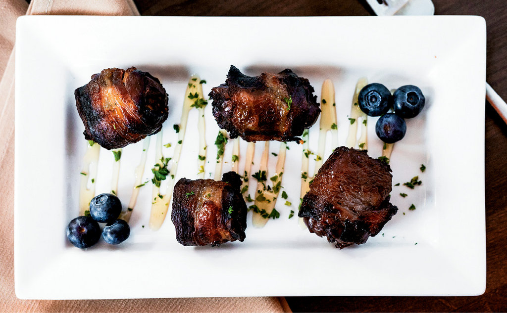 Start to Finish: Above, blue cheese-stuffed, bacon-wrapped dates served with a honey drizzle are a favorite appetizer at the restaurant.