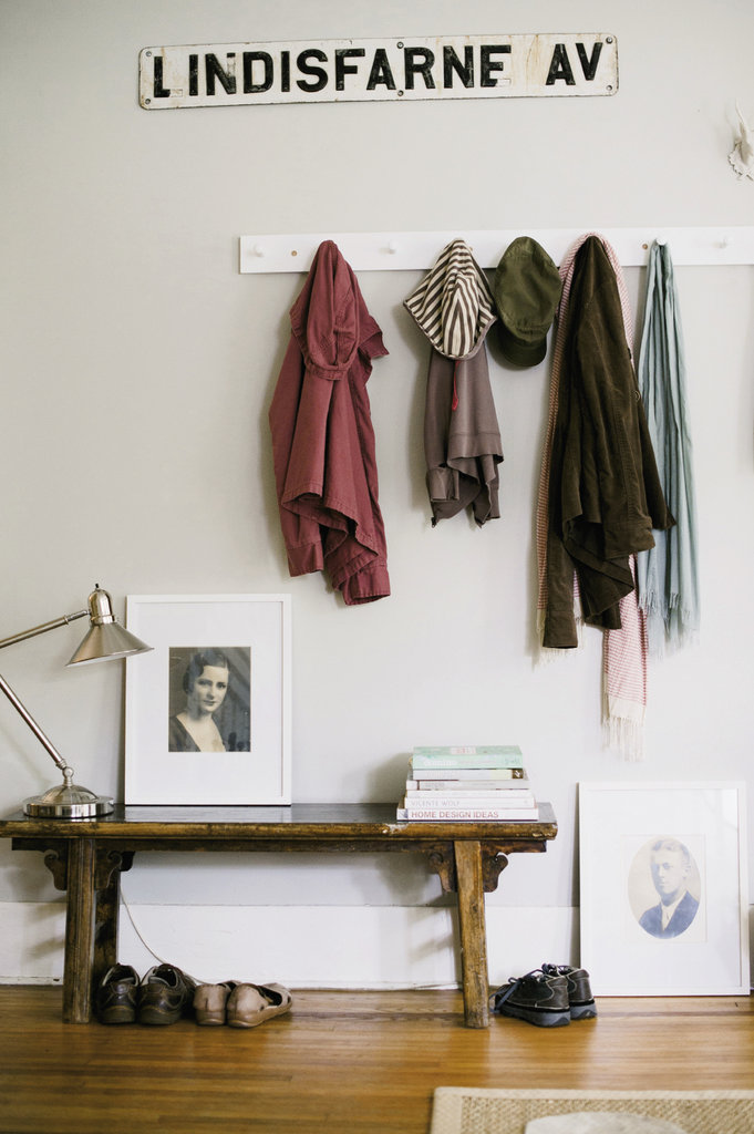To make the most of a tricky layout in the living room, Maria designated one side of the long room as a mock foyer. Photographs of Bill's grandparents personalize the space.