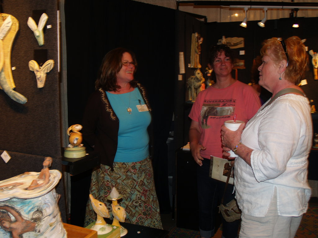 Artisans and patrons mingle around the booths
