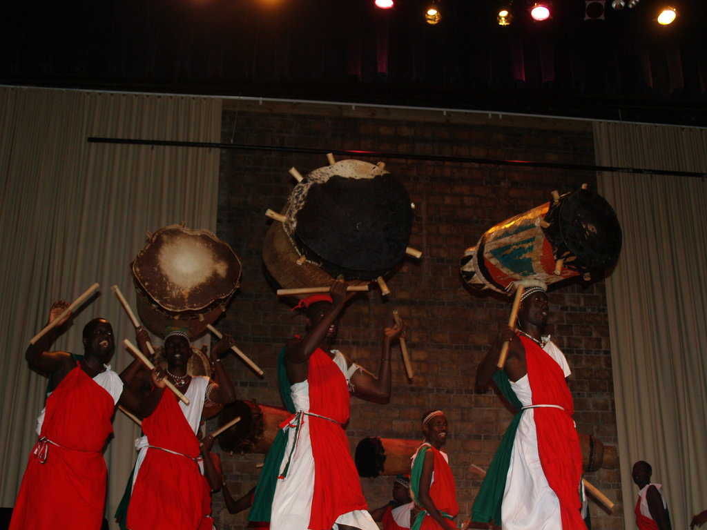 The men of Batimbo balance 150-pound drums on their heads