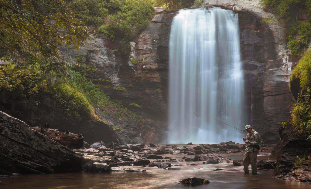 1st PLACE PROFESSIONAL CATEGORY - FISHING BELOW THE FALLS - Patrick Williams - Normally packed with visitors in the summer, Looking Glass Falls at dawn is a peaceful place for local fly-fisherman Zane Porter.  Professional category