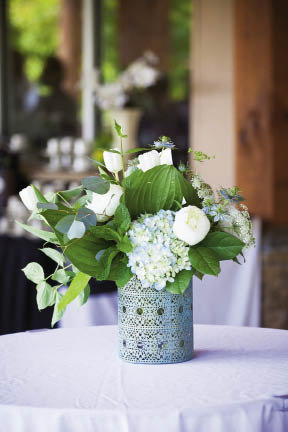 The floral designs and centerpieces were provided by Blossoms of Biltmore Park.