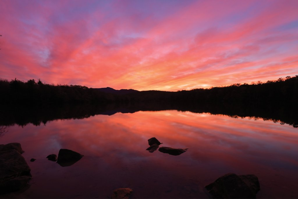 Orange Crush - Tranquil water reflects the blushing sky at Price Lake near Blowing Rock.