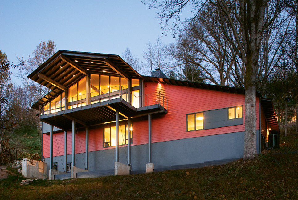A modern steel deck with a cantilevered roof and cable railing provides unobstructed views.