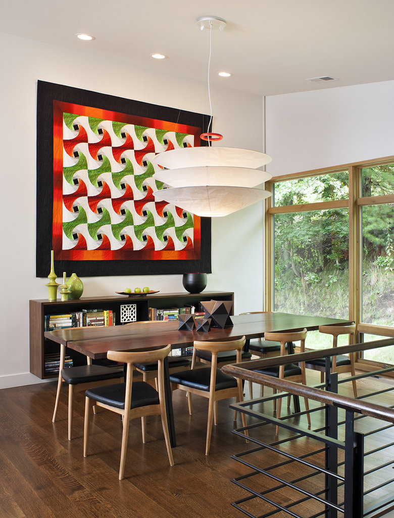 In the dining room, architect Rob Carlton designed the table and sideboard. Homeowner Kim Juran designed and produced the quilt on the wall.