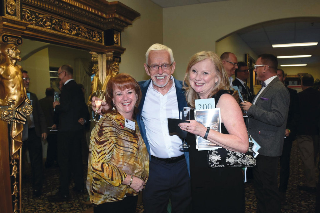 Auction Chair Pam Siekman, Harry Brown, and WNCAP board member Jacque May