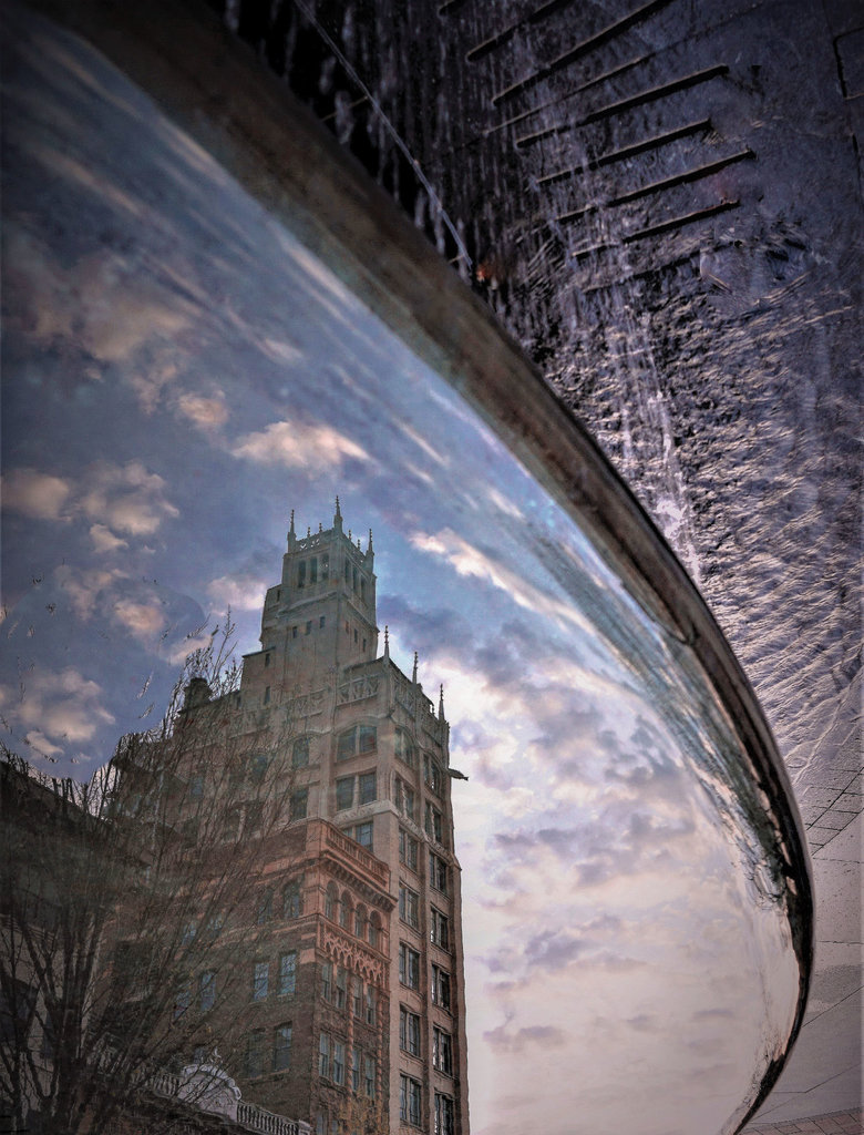 AMATEUR CATEGORY - Fountain Reflection - Michael Boulos - In Asheville, the historic Jackson Building and its gargoyles are reflected in a fountain in Pack Square Park.