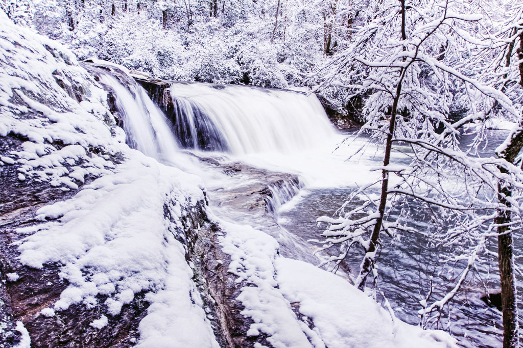 Cool runnings The Little River flows through the snow-covered landscape and over Hooker Falls in DuPont State Forest.