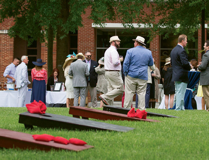 Guests socialized between games of corn hole.