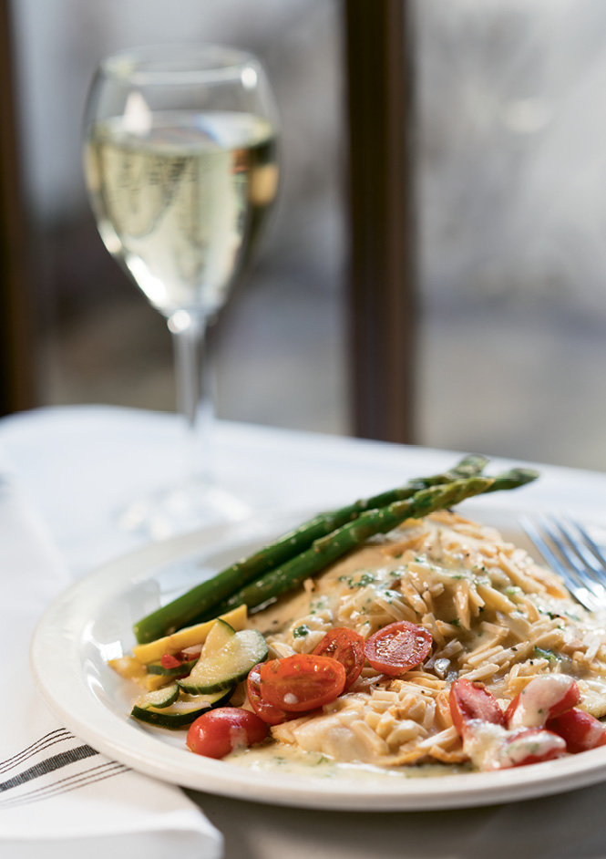The almond-crusted Carolina trout is fresh with bright vegetables and an herbed scallop beurre blanc.