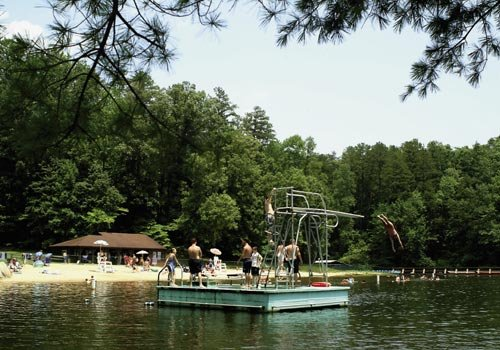 A plunge off the diving platform on Pinnacle Lake is a refreshing way to beat the Upstate summer heat, whether you prefer belly-flops or forward tucks.