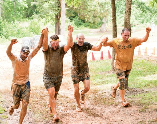 Team Eaton MUD celebrated finishing together.