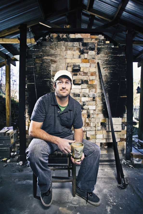 Keith Phillips built the wood-fired kiln behind his Fletcher studio.