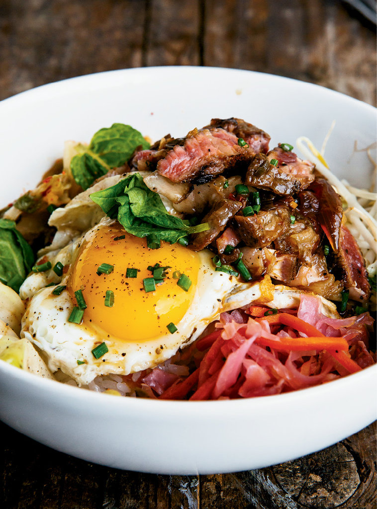 Bowled Over - With crisp vegetable sprouts, caramelized teriyaki, spicy kimchi, pork belly, and a fried egg, the hefty pork belly rice bowl is one of Haywood Common's most popular dishes.