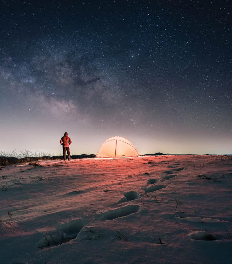 Starstruck - As day begins to break at Max Patch, a popular bald along the Appalachian Trail in Madison County, a camper turns their gaze to a star-studded winter sky