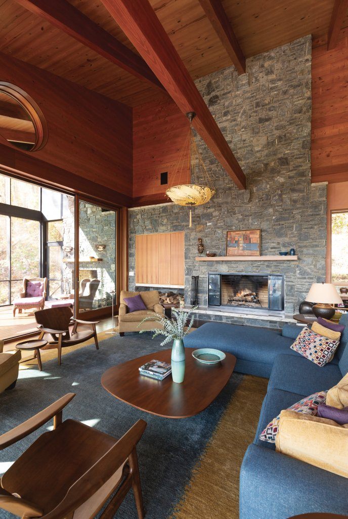 While modern homes can feel cold and sterile, in this case, earthy materials and colors and ample natural light fill the home with warmth. The great room and screened porch are welcoming and perfect for entertaining.