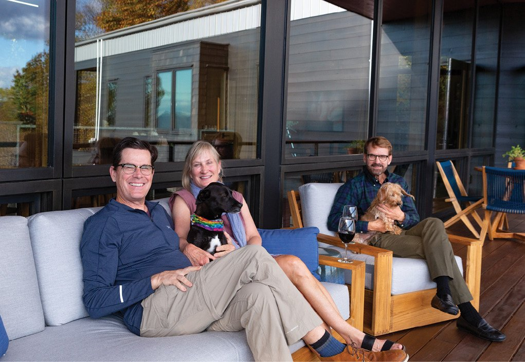 Architect David Gauld (far right) designed the modern Asheville residence for his sister and brother-in-law, Pam and Todd Eveland.