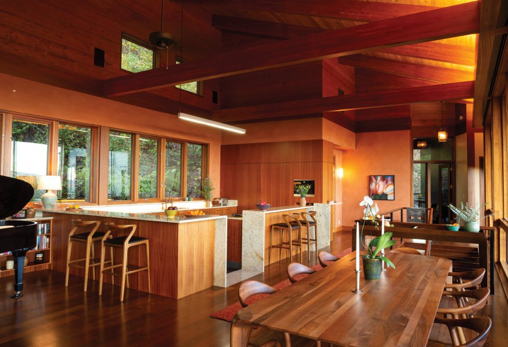 Warm Welcome - While the exterior blends with the forested surroundings, the interior is full of warmth, realized with various wood surfaces and clay plaster walls.