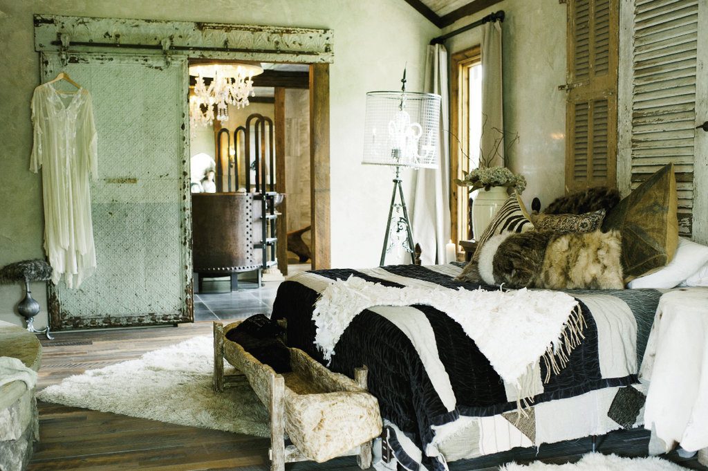 Lavish and rustic elements pair elegantly in the master bedroom