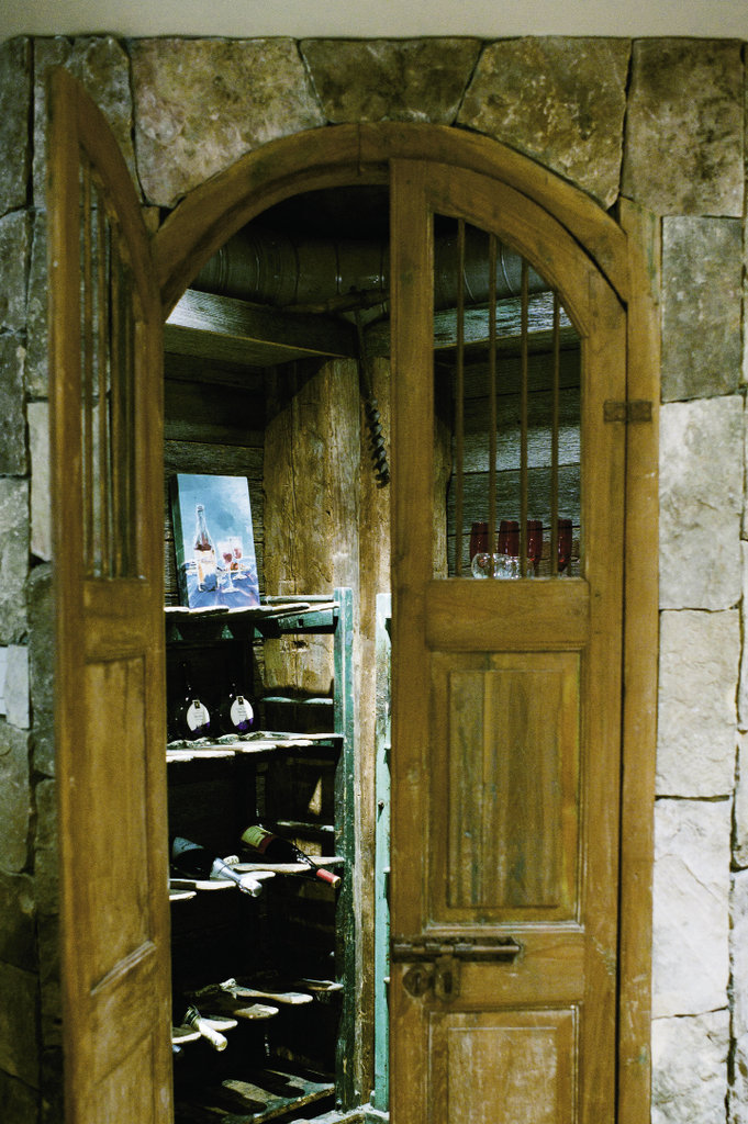 almost every door in the home is salvaged, including the arched entry that inspired the wine closet downstairs.