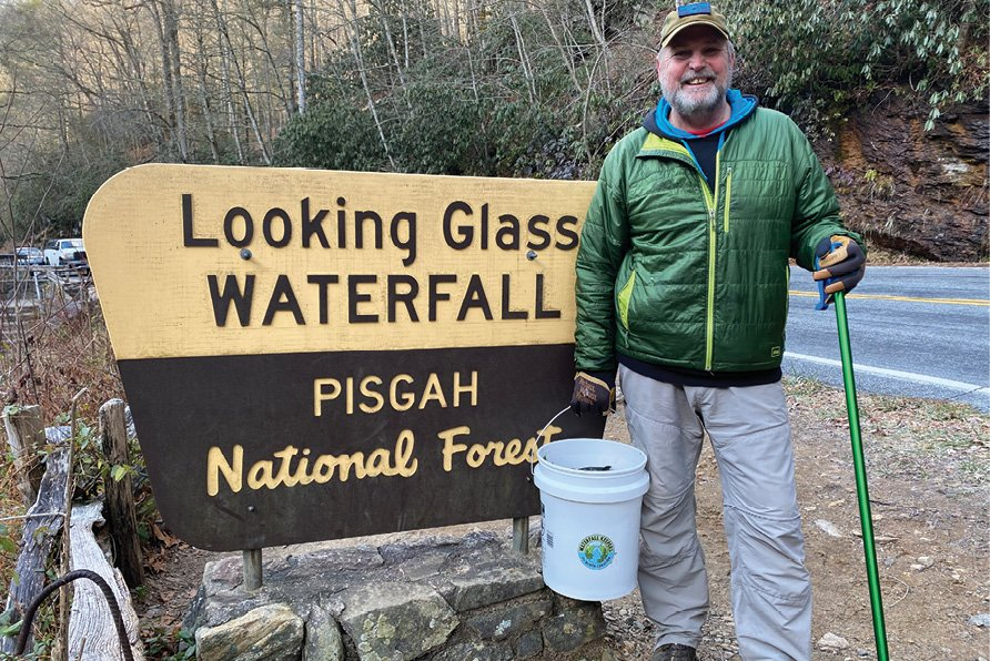 Volunteer Steve Matadobra helps with a cleanup at the popular Looking Glass Waterfall near Brevard.