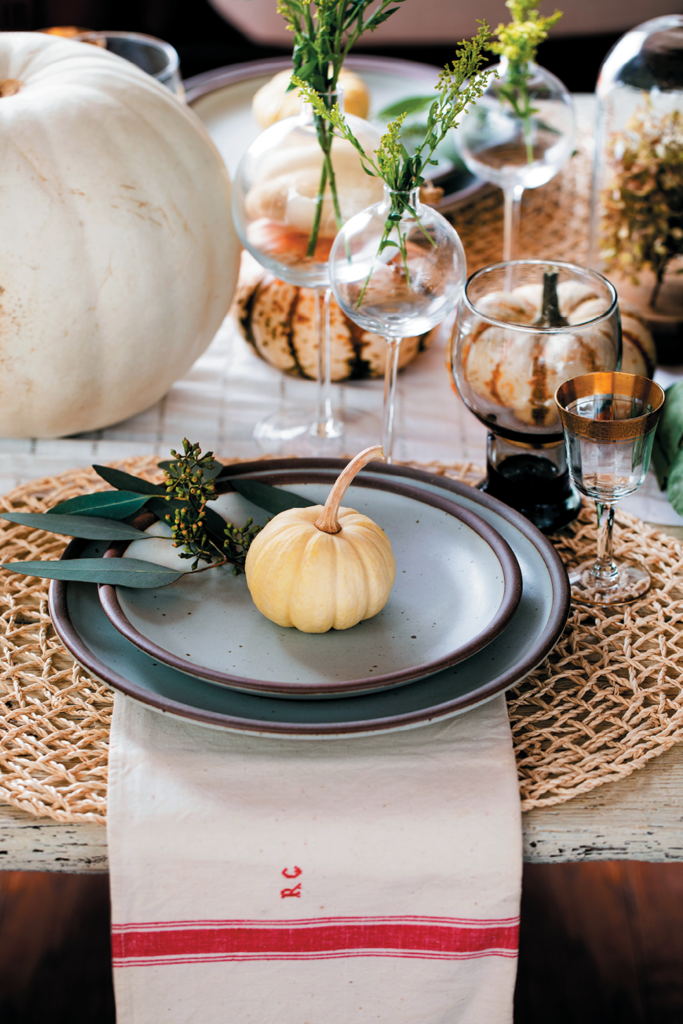 Nature Wins - Hinton is not a fan of faux anything. She understands it's sometimes easier to buy a faux pumpkin that you can reuse every year, but, she says, if you really want to make an impression, go with fresh pumpkins, squash, or greenery. An easy tip for a high-quality look is to place fresh herbs such as rosemary on your guest's plate or tie it up in their napkin. It not only looks beautiful, but the fragrance is divine.