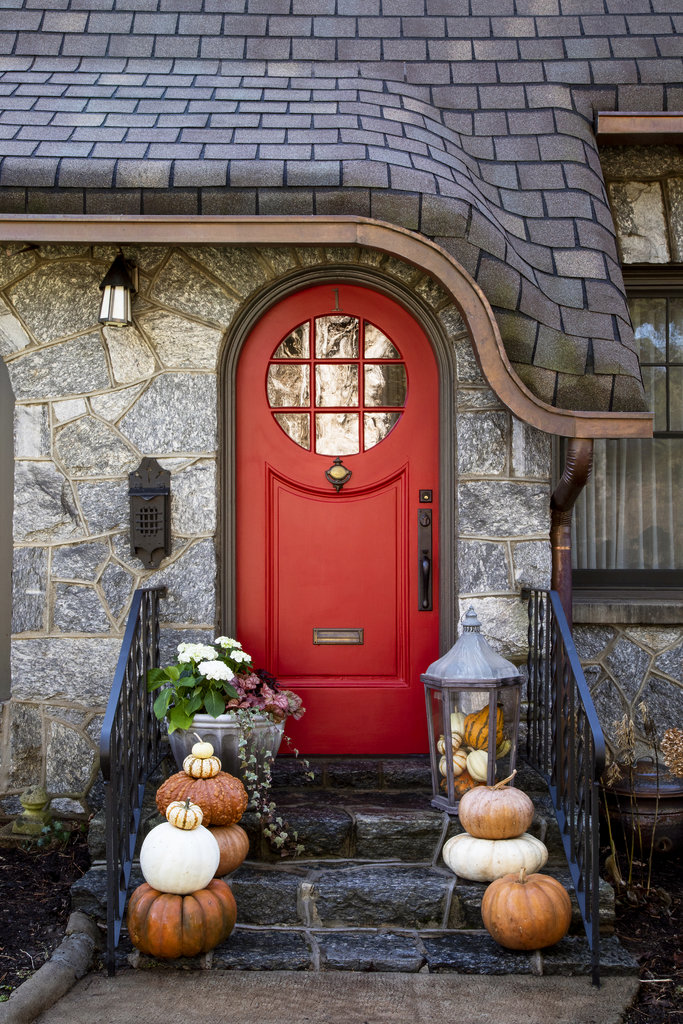 Complement Your Home  - When decorating a porch with pumpkins, it's important to select colors that will complement your home's exterior. Orange pumpkins are great against earth tone homes or rustic siding but may clash with certain bright colors. Pay attention to your door color as well. If you have a warm-colored door such as red or yellow, shy away from orange pumpkins and opt instead for an heirloom color like grey or white