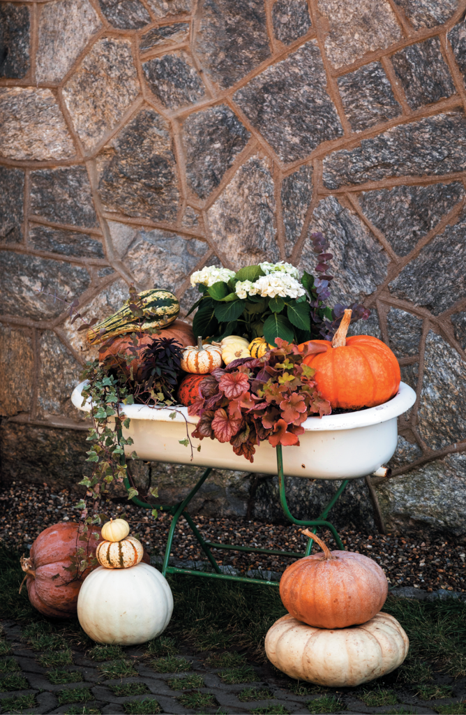Try an outside-the-box outdoor planter that rotates with the seasons; Stacked pumpkins add a whimsical touch.