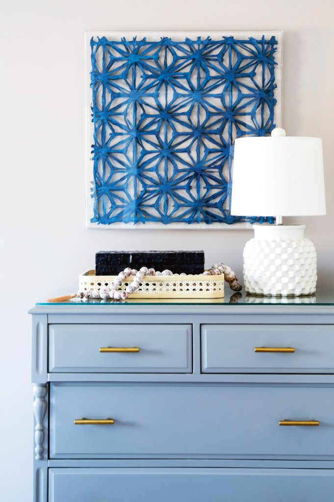 Something Blue - A family heirloom dresser underwent a major transformation with a professional paint job and new sleek hardware. The piece brings a touch of history and color to a serene guest bedroom.