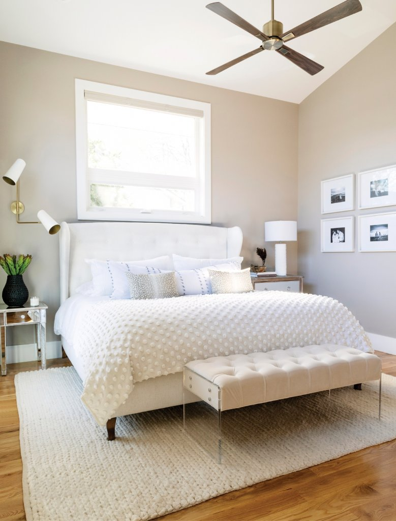 Calm, Cool & Collected - The master bedroom is a soothing nest for the busy couple. After years of moving from city to city, the experiences they collected are featured on a photo gallery wall.