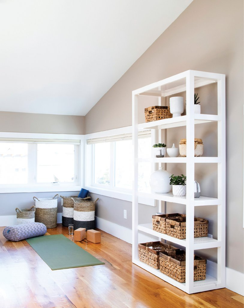 Above it All - The mezzanine pulls triple duty, serving as a yoga space, office, and reading nook.