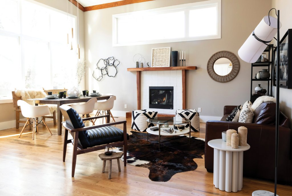 Mixing it Up - Designer Courtney Hinton worked with the new home's modern bones while introducing warmth with rustic pieces, like the primitive milking stool from Croatia adjacent a mid-century style leather chair in the great room.