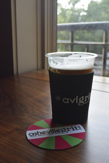 Beer koozies and costers were among the Asheville Grit swag.