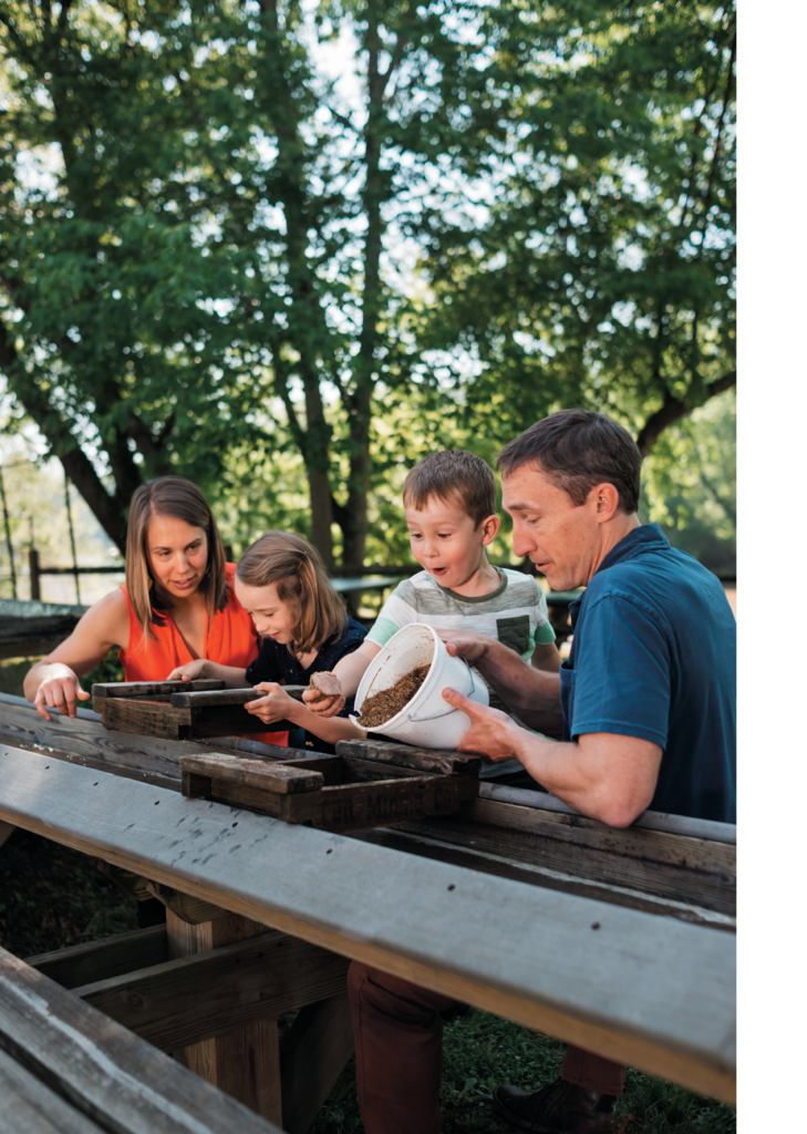 Making discoveries at the Asheville Outdoor Center's kid-friendly mining sluice is great fun for families.