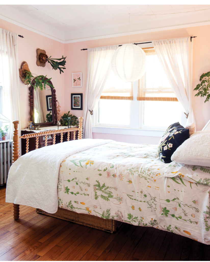 Annabelle's bedroom is full of natural and magical touches, from the floral bedspread and pillow to the rabbit curtain holders to dainty vials of fairy magic. Mounted ferns and botanical prints bedeck the walls.