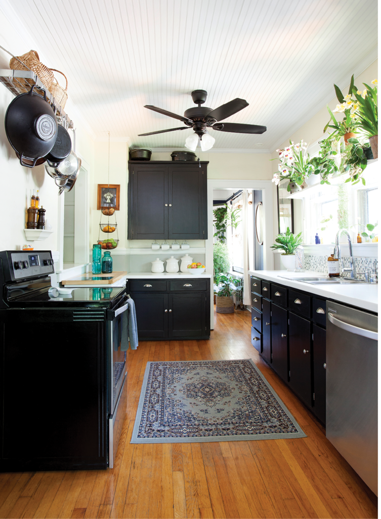 In the kitchen, the couple kept it clean and classy, with black cabinets against white walls and a beadboard ceiling Patrick installed.
