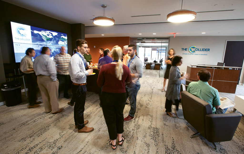 """More than just a co-working space, The Collider is meant to promote collaboration among climate scientists and related businesses. Friday morning """"PercCollider"""" coffee socials are an opportunity for such exchanges."""