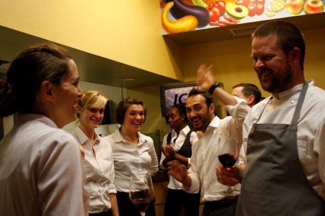 Chefs Katie Button (far left) and Gunnar Karl Gislason (far right) with their teams of cooks