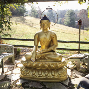 A statue of Buddha adds a sense of peace to the grounds.