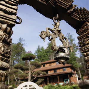 A hand-carved  arbor with dragon-embellished metal bell.