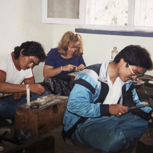 Cook studying traditional craft techniques with Nepali masters in 1992.