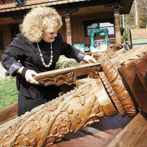 Cook sorts carved columns and cornices imported from Nepal.