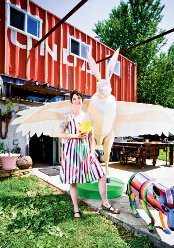 Lemanski outside her Spruce Pine studio with 21st Century Super Species: Jack-dor and Coyote.