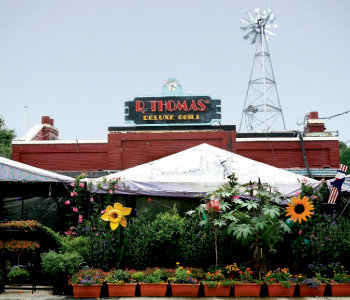R. Thomas' tented dining room, eclectic yard décor, and abundance of plants stand out in Midtown.