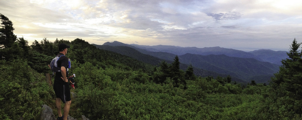 ason takes in an early morning view along the 11.5-mile Black Mountain Crest Trail, which holds five out of the top 10 highest peaks in the East.