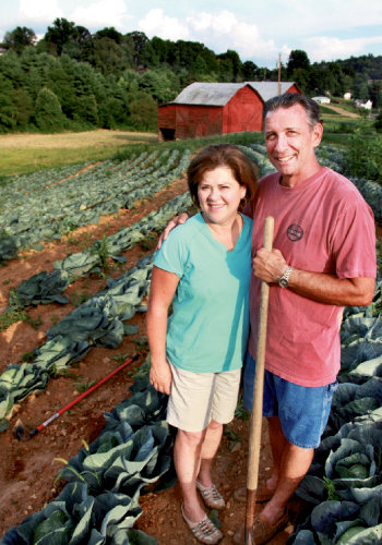 Susie and A.C. Honeycutt amid a crop that will supply local food banks