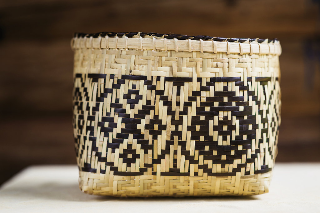 """""""If you ever had to bust up all that cane, you'd know that was actually a million-dollar basket.""""  _Basket maker Mary Thompson"""