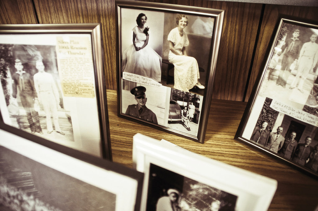 Family members bring historic photos and clippings to share.