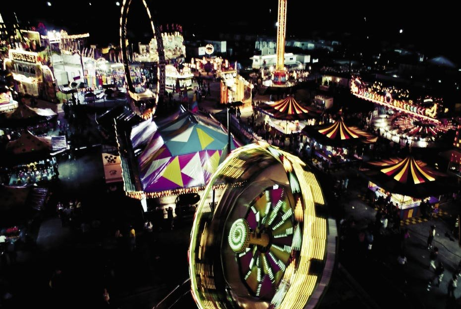 The Midway at Night, when viewed from high above the noise, heat, and crowds, the fair is a mass of swirling—even dancing—colors.