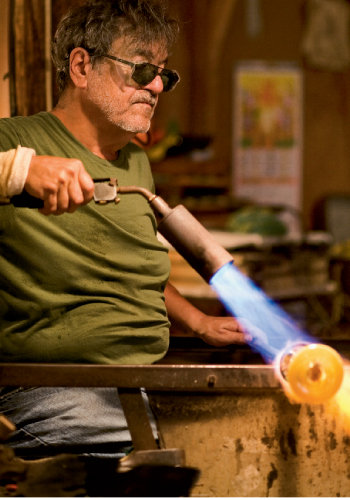 Billy Bernstein creates glass sculptures, which are later painted by his wife, Katherine.